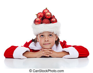 Dreaming of christmas - boy with many decorations in his...