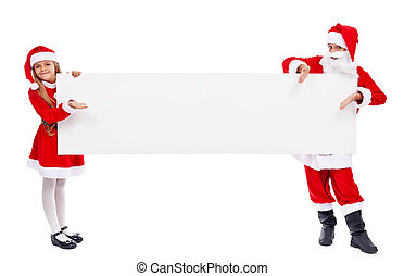 Kids dressed as santa offering you a copy space on banner