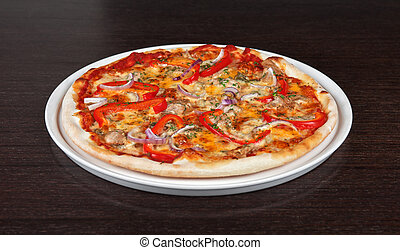 meat pizza with vegetables at the table