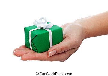 Small gift box in woman hand - christmas present, isolated