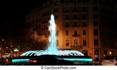 Fountain with blue light in street where you can hear the...