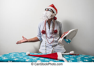 funny santa claus babbo natale ironing on white background
