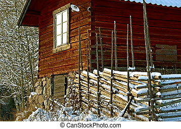 Red house and fence - Red log house with wooden fence in...