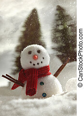 Little snowman with winter snow background