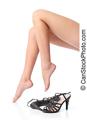 Beautiful woman smooth and waxed legs and feet with a heels...