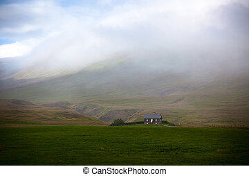 Icelandic Landscape: Lonely House in Foggy Mountains...