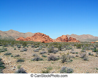 Outcrop - On the desert floor many lone outcrops appear as...