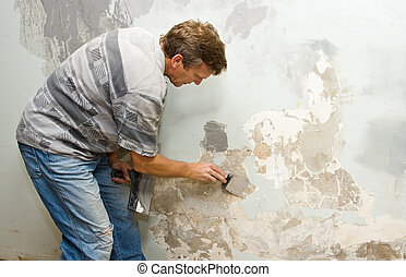 Plastering - Plasterer at work doing indoor house repair...