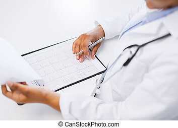 deg;male doctor studies cardiogram - healthcare and medical...