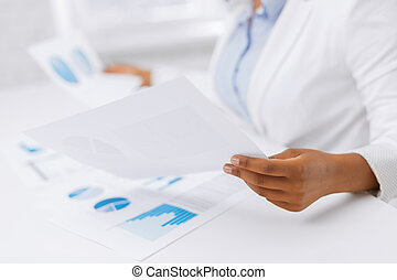 woman hands with charts and papers - business, office, tax,...