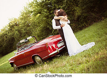 Wedding car with bride and groom - Gorgeous bride and groom...