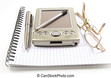 Vignetting image of pen, PDA and eyeglasses on spiral...