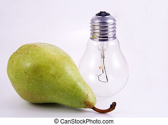Green pear and electric bulb on white