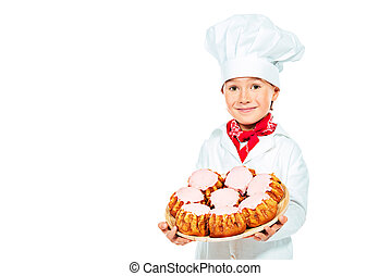 pastries kid - Portrait of a little boy cook holding...