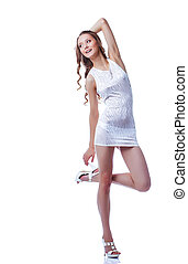 Cheerful long-haired model posing in short dress, isolated...