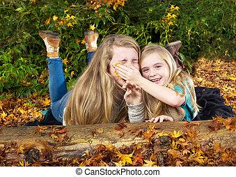 Sisters having fun in the fall season