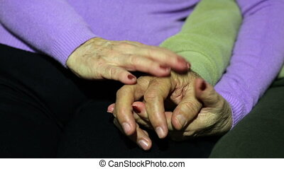 Senior couple holding hands - Senior couple holding their...