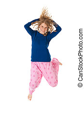 Jumping in pajamas - Young woman is jumping in blue and pink...