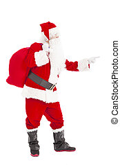 merry Christmas Santa Claus holding gift bag and pointing