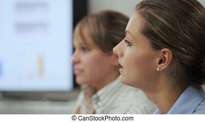 two women speaking at meeting
