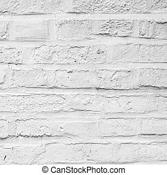 old white painted bricks at an old house wall