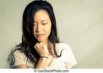 Woman crying and pulling hair - Young woman crying while...