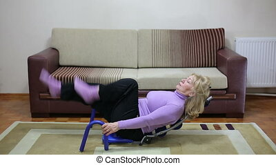 Senior woman exercising in her living room