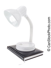 Night lamp shade on the diary notebook. On a white...