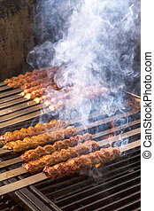 Cooking Adana Lamb Kebabs on the Restaurant Style Grill -...