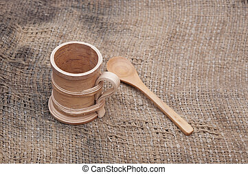wooden utensils on old worn burlap
