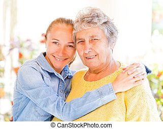 Elderly woman and her daughter