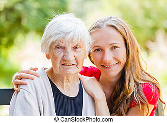 Elderly home care - Portrait of elderly woman and her...
