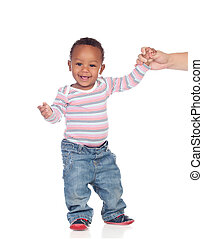 Beautiful African American baby learning to walk isolated on...