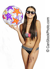 Bikini girl with a ball on a white background