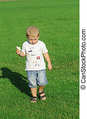 Little boy eating ice cream in the park