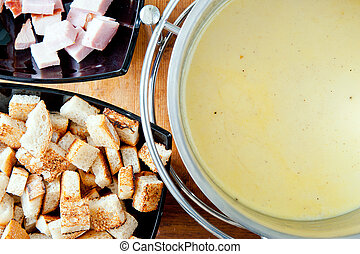 Cheese fondue - Swiss traditional cheese fondue with ham and...