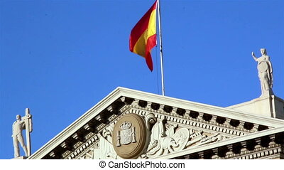 Flag of spain on top of building