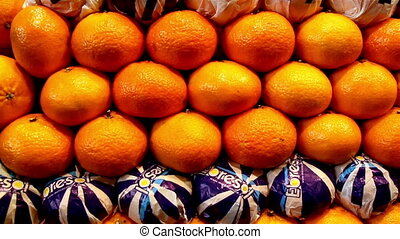 Orange neatly piled lots of oranges on display - Orange...