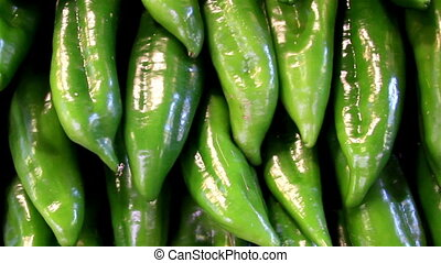 Big green sweet peppers paprika chilli pepper neatly piled -...