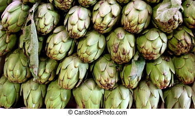 Closer image of the eco artichokes and some leaf - Closer...