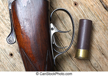 vintage hunting gun with shells - vintage hunting gun with...