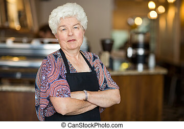 Senior Business Owner in Cafe - Portrait of beautiful senior...