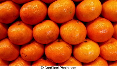 Close up view of the piled orange. Oranges are very rich in...