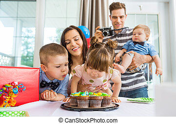 Family And Children Celebrating Birthday At Home - Family...