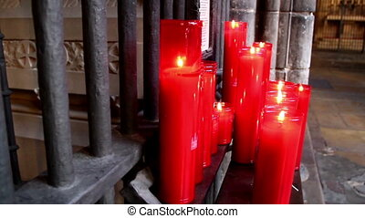 Pile of lighted red candles in church - Pile of lighted red...