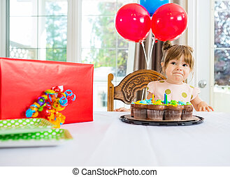 Birthday Girl With Cake And Present On Table