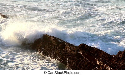Waves smashing on the stones big waves splashing on big rocks