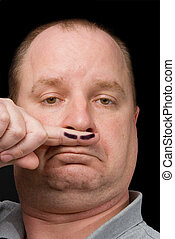 Fake Moustache - A man sporting a fake moustache on his...