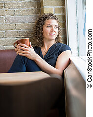 Woman With Coffee Mug In Cafeteria - Thoughtful woman with...