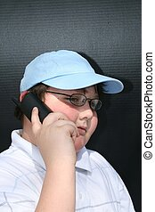 Young man talking on telephone - young man talking on...